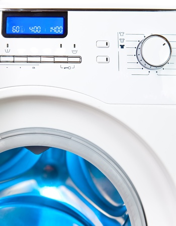 capacious: The washing machine - a close up of the display, the manhole and a choice of programs Stock Photo