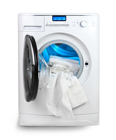 The washing machine with an open door and linen photo