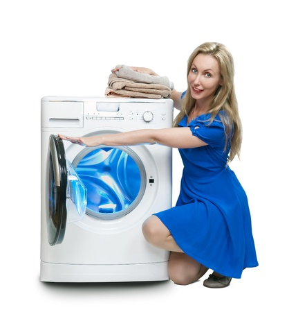 The happy young woman near the new washing machine   photo