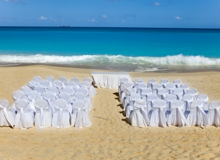 Chairs and tables waiting Wedding on tropical beach.  photo
