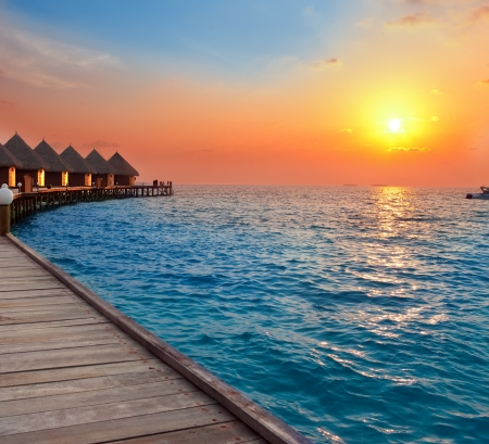 Island in ocean, Maldives.  Sunset