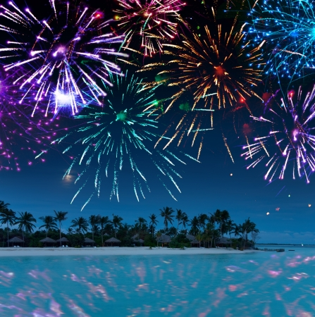 anniversary beach: Festive New Years fireworks over the tropical island