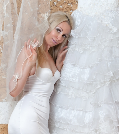 The happy bride tries on a wedding dress Stock Photo
