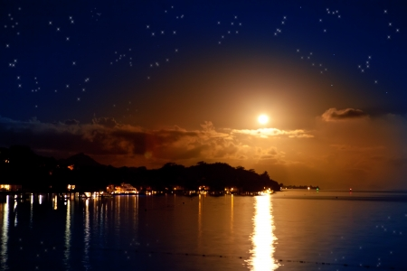 Night  The moon over the sea and reflection in water