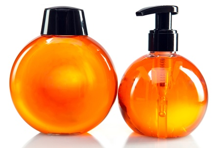 Two bright color cosmetic small bottles with the dispenser photo