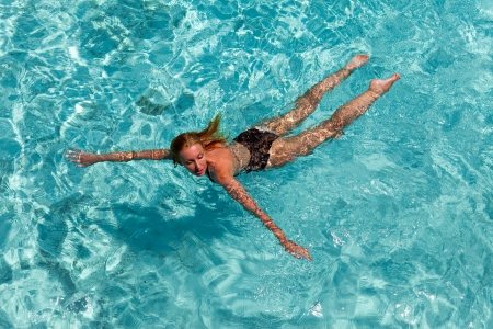 exotic woman: The woman swims in the sea