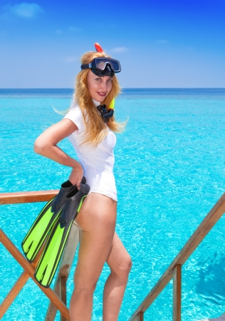 Young pretty woman with flippers, mask and tube.  Maldives.   photo