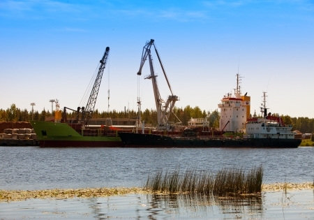 Cargoship unloading on the river Luga. Russia Stock Photo - 18383806