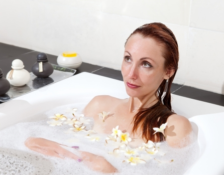 soapsuds: woman lays in soapsuds in bathing, full water