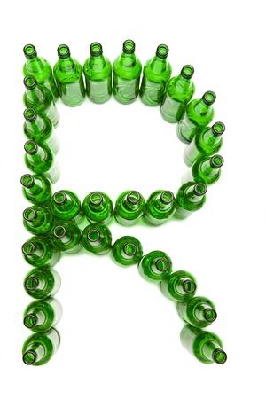 The alphabet from glass beer bottles. Letter   R photo