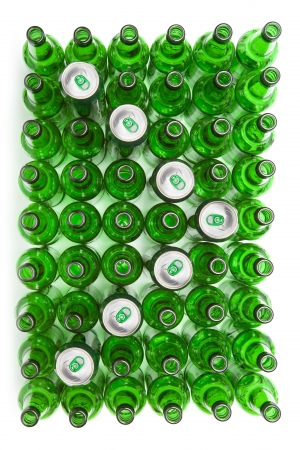 Empty glass beer bottles and cans photo
