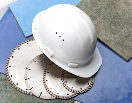 Diamond discs for tile cutting and a helmet on a tile Stock Photo - 19065785
