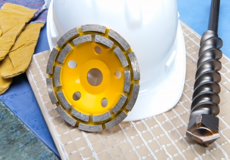 disks for concrete, drill and a helmet on a tile photo