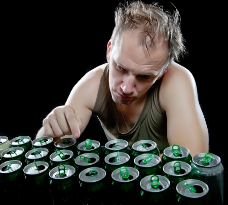 sobriety: Hangover. The drunk man enumerates empty beer cans
