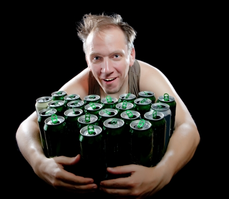 sobriety: The drunk man and is a lot of empty beer cans