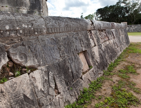 Chichen Itza . Fragment of a wall of a pyramid with an ancient ornament. Yucatan, Mexico photo
