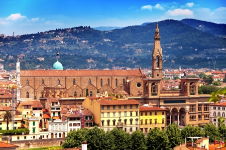 signoria square: The clock tower of the Old Palace (Palazzo Vecchio) in Signoria Square, Florence (Italy).   Stock Photo