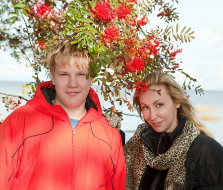 mountain ash: Young people at a mountain ash bush
