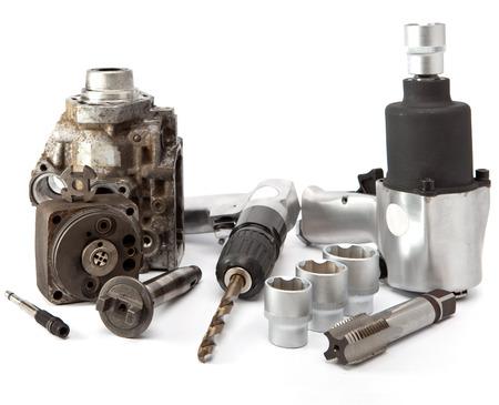 Car repair - details of the pump of high pressure, air impact wrench, air drill   photo