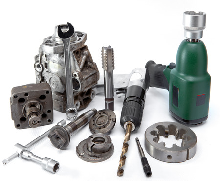 impact wrench: Car repair - details of the pump of high pressure, air impact wrench, air drill on white background