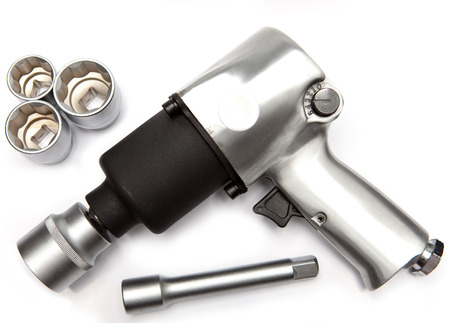 impact wrench: air impact wrench and edge heads on white background