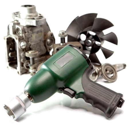impact wrench: Car repair - details of the pump of high pressure and air impact wrench on white background