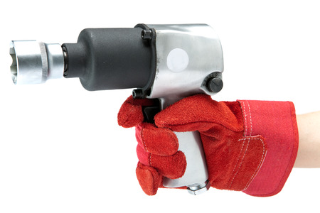 impact wrench: hand in a working glove holds air impact wrench Stock Photo