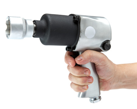 impact wrench: the hand holds air impact wrench