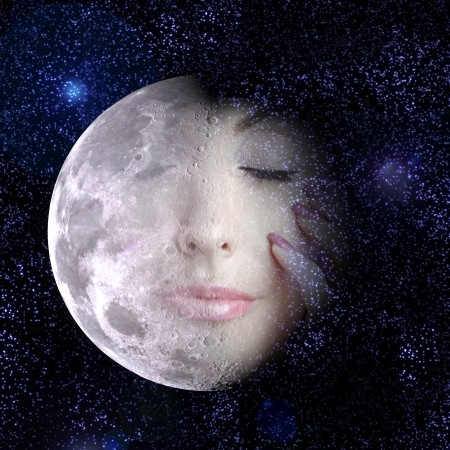 The moon turns into a face of the beautiful woman in the night sky. photo