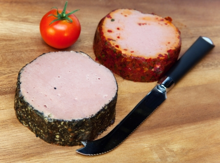pastes: Two meat pastes, special knife and tomato Stock Photo