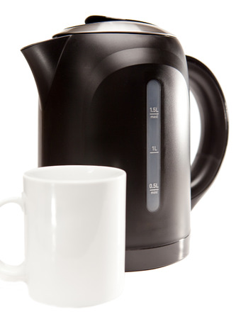 electric tea kettle: electric tea kettle on a white background and a mug   Stock Photo