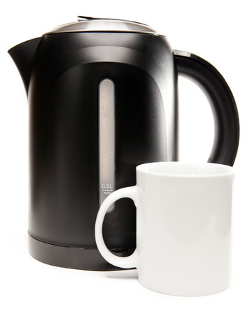 electric tea kettle on a white background and a mug photo