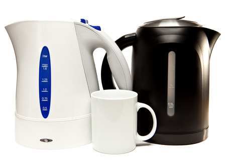 electric tea kettle:   two electric tea kettle on a white background and a mug