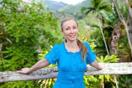 soroa: Cuba. The beautiful woman in a  blue dress in park of Soroa (Jardin Botanico Orquideario Soroa)