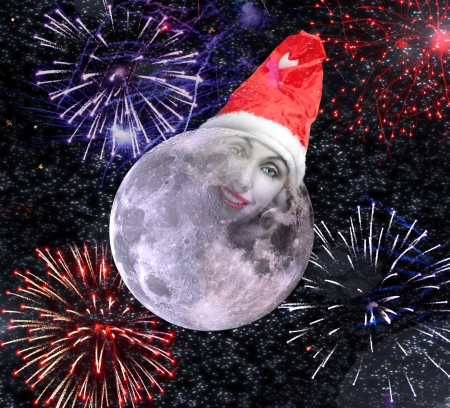 The moon smiles in the New Years cap against salute photo
