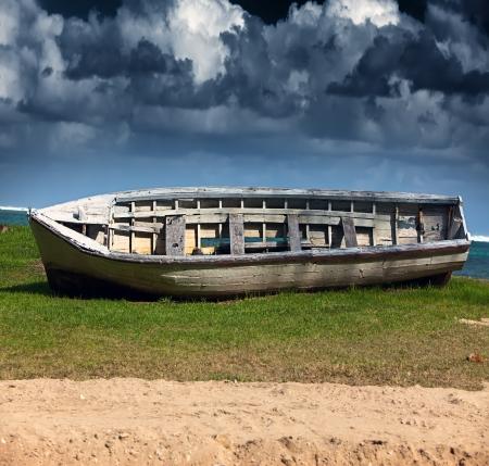 overturned overturn: The turned boat on seacoast