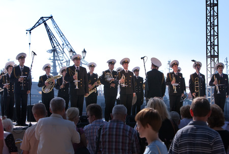 anthem: KRONSTADT, RUSSIA - AUGUST 27: military band musicians perform on a city holiday, devoted to the 150th anniversary of Petrovsky park in August 27, 2011 in Kronstadt, Russia