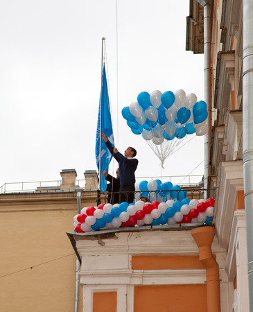 SAINT PETRSBURG - SEPTEMBER 1: Raising of a school flag on the first day of school on September 1, 2011 in Saint-Petersburg, Russia.