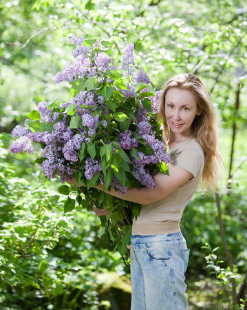happy young woman in park with a big bouquet of a lilac Stock Photo - 27646166