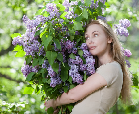 happy young woman in park with a big bouquet of a lilac Stock Photo - 27646167