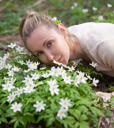 The young beautiful woman in the field of blossoming snowdrops in the early spring Stock Photo - 27646173