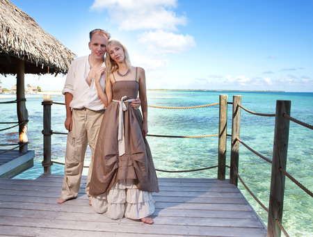 borabora: Loving couple on a wooden platform over the sea on the tropical island Stock Photo
