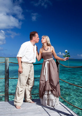 borabora: Loving couple on a wooden platform over the sea on the tropical island