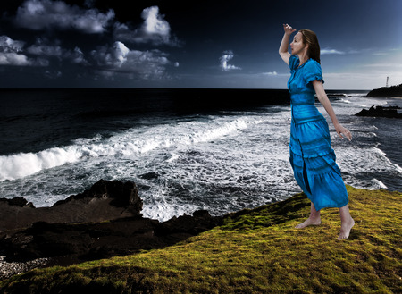 storming: The woman on the edge of a breakaway over the storming sea