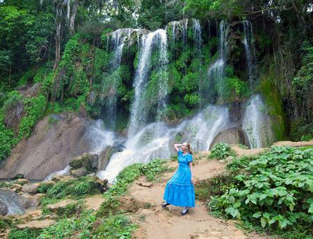 soroa: the woman in a long dress near waterfalls Soroa, Pinar del Rio, Cuba   Stock Photo