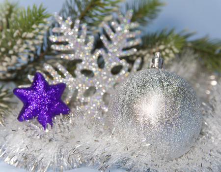 the silvery: Silvery New Years ball and decorative snowflake