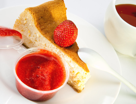 fruitcake: Fruitcake with a strawberry and a cup of tea