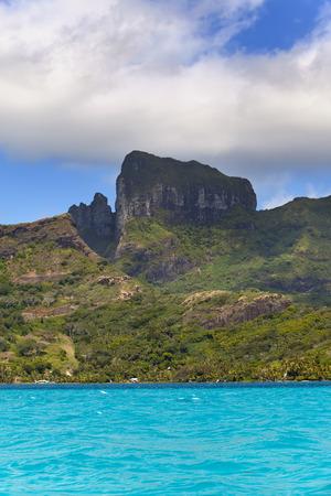 borabora: Azure lagoon of island BoraBora, Polynesia. Mountains, the sea,  trees.