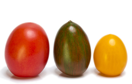 grades: tomatoes of different grades and color Stock Photo