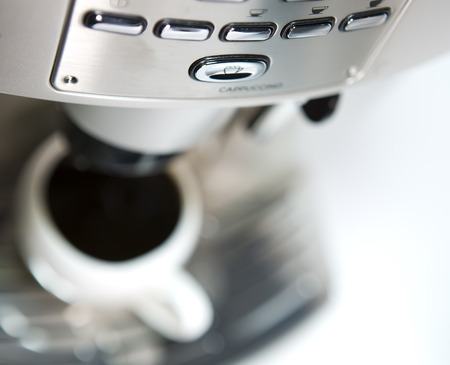 sharpness: coffee maker and cup, small depth of sharpness